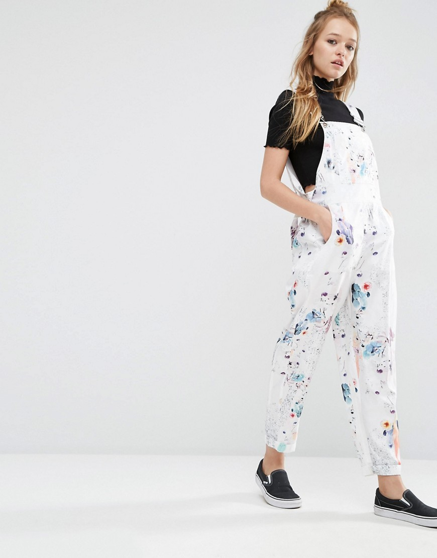 Dungaree Jumpsuit In Floral Print Multi - length: standard; sleeve style: standard vest straps/shoulder straps; predominant colour: white; occasions: casual; fit: body skimming; fibres: polyester/polyamide - 100%; sleeve length: sleeveless; texture group: denim; style: dungarees; neckline: low square neck; pattern type: fabric; pattern size: standard; pattern: florals; multicoloured: multicoloured; season: s/s 2016; wardrobe: highlight