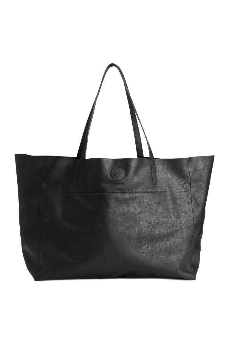 Shopper - predominant colour: black; occasions: casual, work, creative work; type of pattern: standard; style: tote; length: shoulder (tucks under arm); size: standard; material: faux leather; pattern: plain; finish: plain; season: s/s 2016; wardrobe: investment