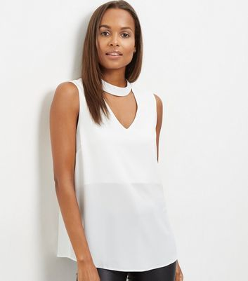 White Cut Out Funnel Neck Sleeveless Top - pattern: plain; sleeve style: sleeveless; length: below the bottom; predominant colour: white; occasions: casual, creative work; style: top; neckline: peep hole neckline; fibres: polyester/polyamide - 100%; fit: loose; sleeve length: sleeveless; texture group: sheer fabrics/chiffon/organza etc.; pattern type: fabric; season: s/s 2016; wardrobe: basic