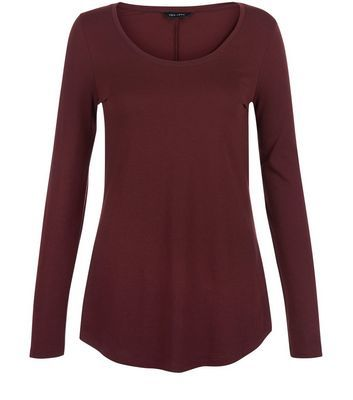 Burgundy Curve Hem Long Sleeve Top - neckline: round neck; pattern: plain; style: t-shirt; predominant colour: burgundy; occasions: casual; length: standard; fibres: cotton - mix; fit: body skimming; sleeve length: long sleeve; sleeve style: standard; pattern type: fabric; texture group: jersey - stretchy/drapey; season: s/s 2016; wardrobe: highlight