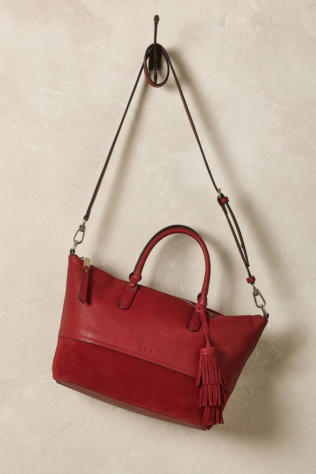 Tamarindo Shoulder Bag - predominant colour: true red; occasions: casual, creative work; type of pattern: standard; style: shoulder; length: shoulder (tucks under arm); size: standard; material: leather; embellishment: tassels; pattern: plain; finish: plain; season: s/s 2016