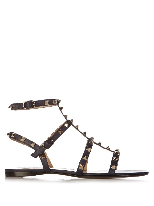 Rockstud Flat Leather Sandals - predominant colour: black; occasions: casual, holiday, creative work; material: leather; heel height: flat; embellishment: studs; ankle detail: ankle strap; heel: standard; toe: open toe/peeptoe; style: gladiators; finish: plain; pattern: plain; season: s/s 2016; wardrobe: highlight