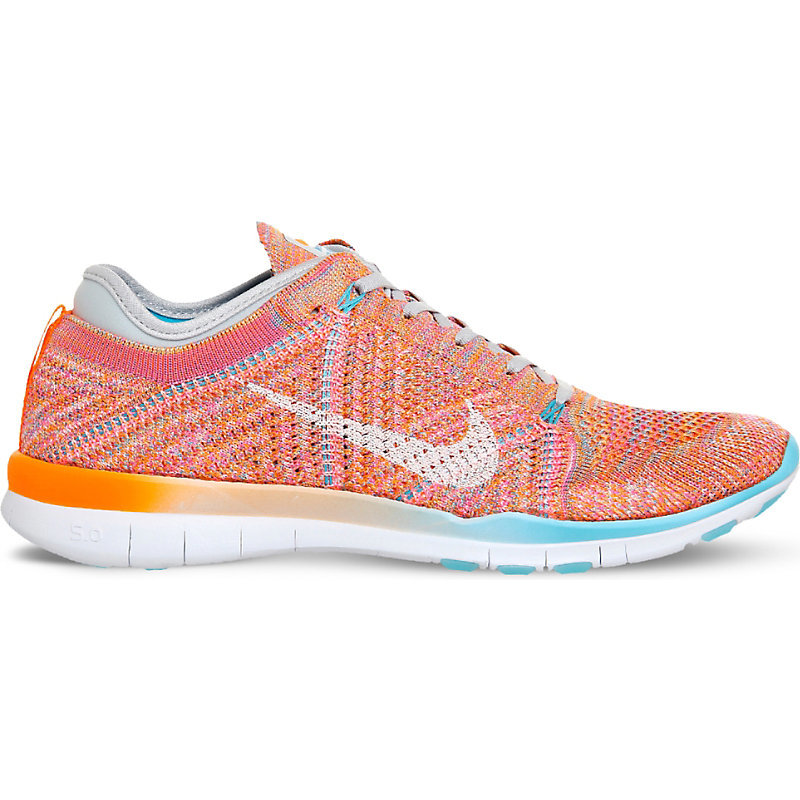 Free Tr Flyknit Trainers, Women's, 6.5, Total Orange Pink - predominant colour: bright orange; occasions: casual; material: fabric; heel height: flat; toe: round toe; style: trainers; finish: plain; pattern: patterned/print; season: s/s 2016; wardrobe: highlight