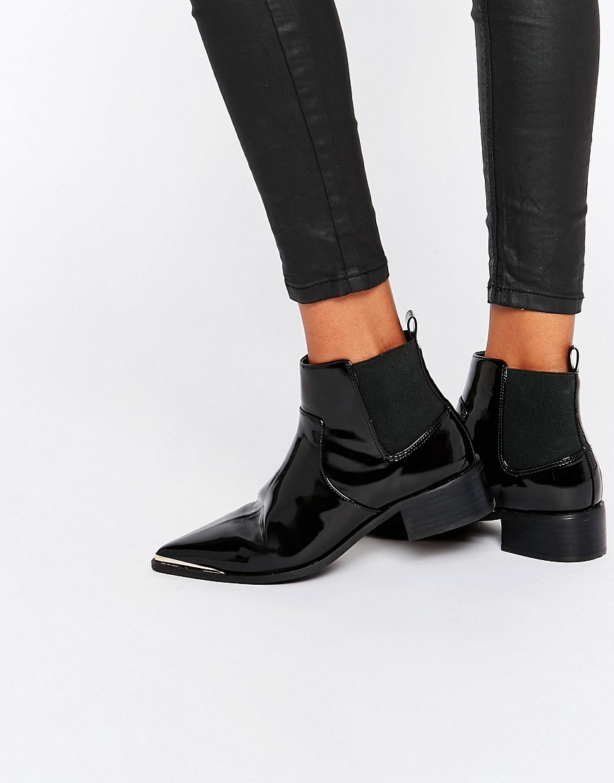 Abbie Chelsea Pointed Ankle Boots Black - predominant colour: black; occasions: casual, creative work; material: faux leather; heel height: flat; heel: standard; toe: pointed toe; boot length: ankle boot; finish: patent; pattern: plain; style: chelsea; season: s/s 2016