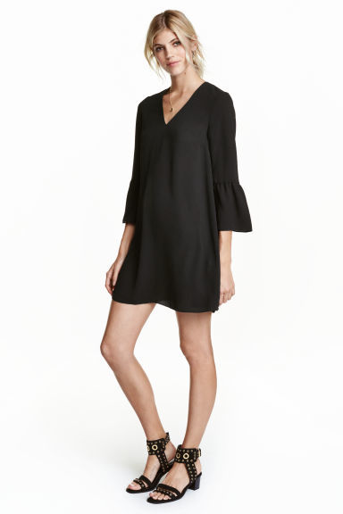 Dress With Trumpet Sleeves - style: shift; length: mid thigh; neckline: low v-neck; sleeve style: bell sleeve; pattern: plain; predominant colour: black; occasions: evening; fit: body skimming; fibres: polyester/polyamide - stretch; sleeve length: 3/4 length; pattern type: fabric; texture group: woven light midweight; season: s/s 2016; wardrobe: event