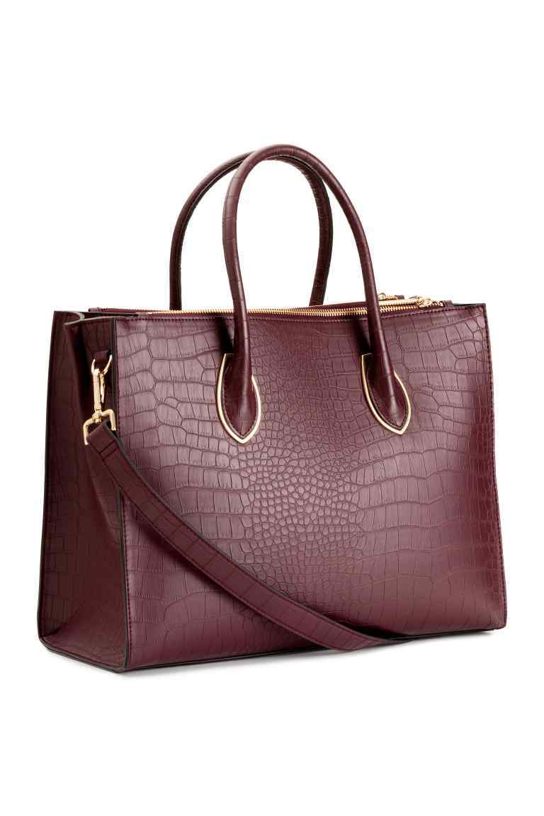 Handbag - predominant colour: burgundy; occasions: work, creative work; type of pattern: standard; style: tote; length: handle; size: oversized; material: faux leather; pattern: animal print; finish: plain; season: s/s 2016; wardrobe: highlight
