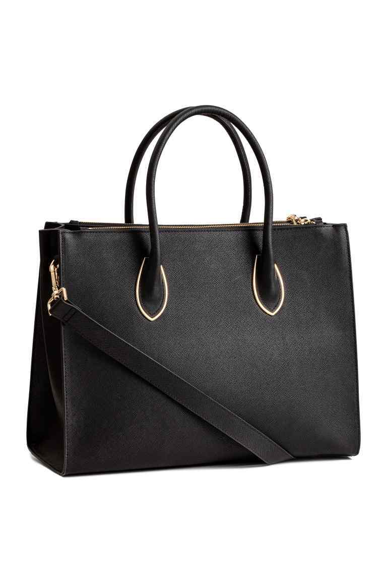 Handbag - predominant colour: black; occasions: work, creative work; type of pattern: standard; style: tote; length: handle; size: oversized; material: faux leather; pattern: plain; finish: plain; season: s/s 2016; wardrobe: investment