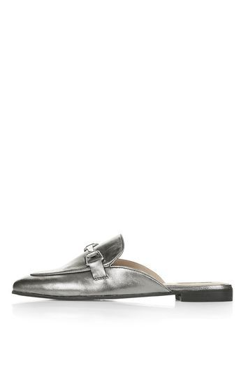 Kylie Backless Buckle Loafer - predominant colour: silver; occasions: casual, creative work; material: fabric; heel height: flat; toe: round toe; style: loafers; finish: metallic; pattern: plain; season: s/s 2016; trends: metallics