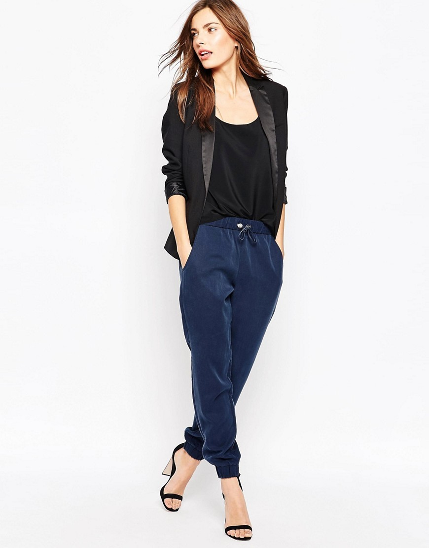 Runaway Drape Trouser Nocturnal - length: standard; pattern: plain; style: peg leg; waist detail: belted waist/tie at waist/drawstring; waist: mid/regular rise; predominant colour: navy; occasions: casual, creative work; fibres: polyester/polyamide - mix; fit: tapered; pattern type: fabric; texture group: other - light to midweight; season: s/s 2016; wardrobe: basic