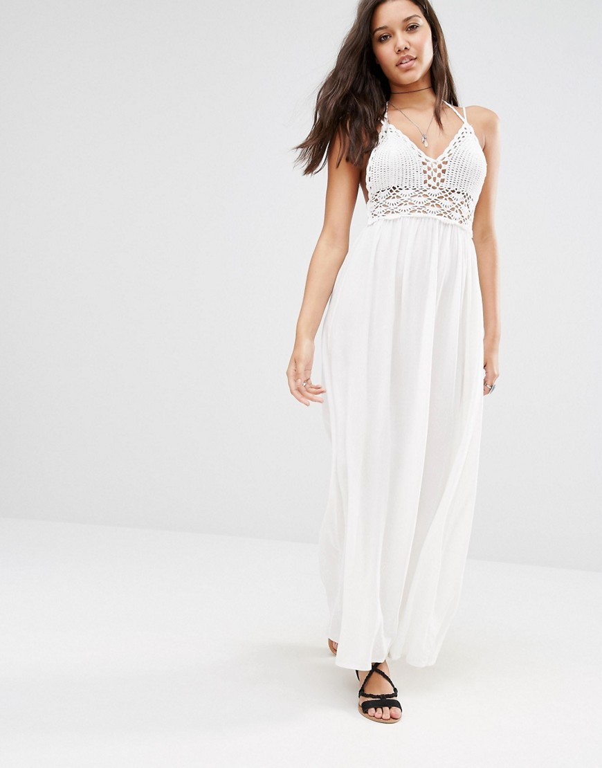 Crochet Top Maxi Dress White - neckline: low v-neck; sleeve style: spaghetti straps; fit: empire; pattern: plain; style: maxi dress; length: ankle length; predominant colour: ivory/cream; fibres: cotton - 100%; hip detail: soft pleats at hip/draping at hip/flared at hip; sleeve length: sleeveless; occasions: holiday; pattern type: fabric; texture group: jersey - stretchy/drapey; embellishment: lace; season: s/s 2016