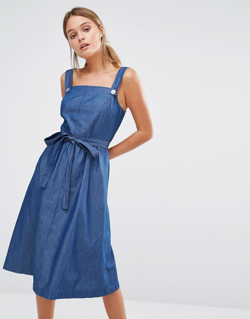 Chambray Pinafore Belted Dress Denim - length: calf length; pattern: plain; sleeve style: sleeveless; style: dungaree dress/pinafore; waist detail: belted waist/tie at waist/drawstring; predominant colour: denim; occasions: casual; fit: body skimming; fibres: cotton - 100%; sleeve length: sleeveless; texture group: denim; neckline: low square neck; pattern type: fabric; season: s/s 2016; wardrobe: highlight