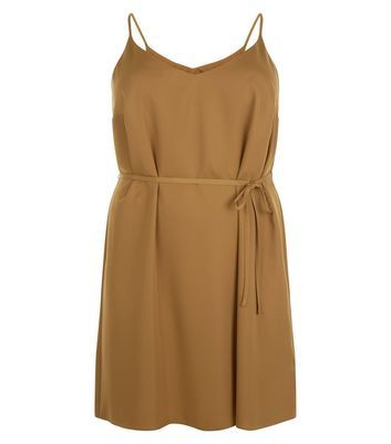 Curves Olive Green Satin Slip Dress - neckline: v-neck; sleeve style: spaghetti straps; pattern: plain; waist detail: belted waist/tie at waist/drawstring; predominant colour: mustard; occasions: casual; length: just above the knee; fit: body skimming; style: slip dress; fibres: polyester/polyamide - 100%; sleeve length: sleeveless; texture group: structured shiny - satin/tafetta/silk etc.; pattern type: fabric; season: s/s 2016; wardrobe: highlight