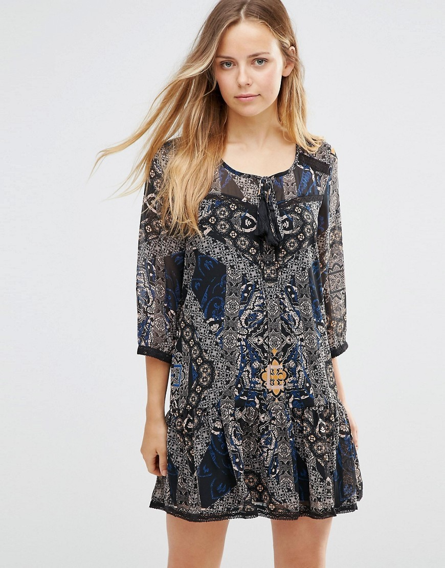 Parki Boho Printed Drop Waist Dress Patch Black - length: mid thigh; neckline: round neck; style: drop waist; pattern: paisley; secondary colour: mid grey; predominant colour: black; occasions: casual; fit: body skimming; fibres: polyester/polyamide - 100%; sleeve length: 3/4 length; sleeve style: standard; pattern type: fabric; texture group: jersey - stretchy/drapey; multicoloured: multicoloured; season: s/s 2016; wardrobe: highlight