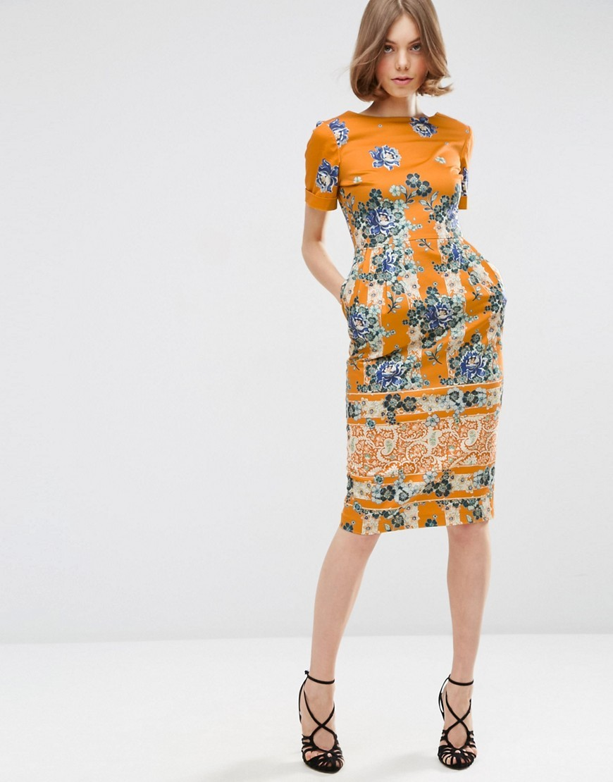Border Print Wiggle Dress In Placement Floral Print Multi - style: shift; length: below the knee; secondary colour: navy; predominant colour: mustard; occasions: evening; fit: body skimming; fibres: cotton - stretch; neckline: crew; sleeve length: short sleeve; sleeve style: standard; pattern type: fabric; pattern size: big & busy; pattern: florals; texture group: jersey - stretchy/drapey; multicoloured: multicoloured; season: s/s 2016; wardrobe: event