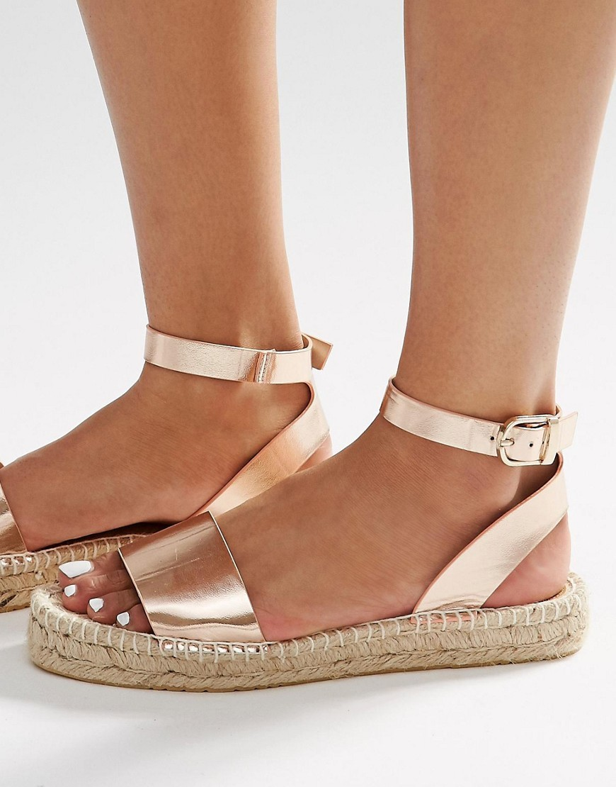 Joni Espadrille Sandals Rose Gold - predominant colour: gold; occasions: casual, holiday; material: faux leather; heel height: flat; ankle detail: ankle strap; heel: block; toe: open toe/peeptoe; style: strappy; finish: metallic; pattern: plain; season: s/s 2016; wardrobe: basic