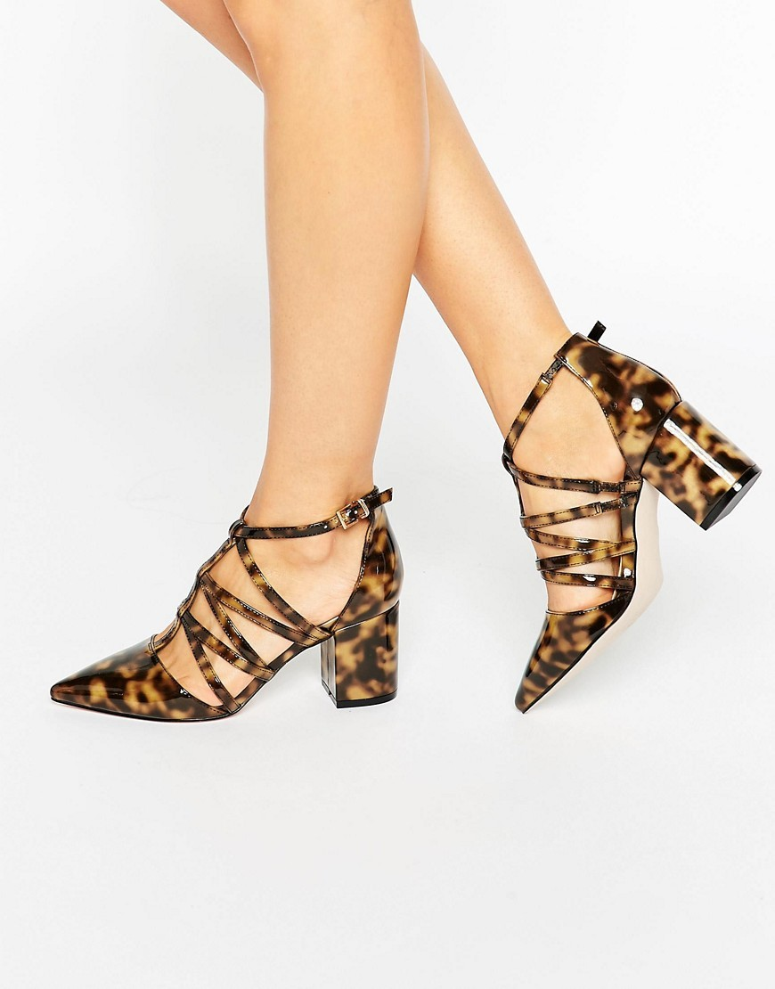 Surreal Caged Pointed Heels Tortoise - predominant colour: chocolate brown; occasions: evening, occasion; material: faux leather; heel height: high; ankle detail: ankle strap; heel: block; toe: pointed toe; style: courts; finish: plain; pattern: animal print; season: s/s 2016; wardrobe: event