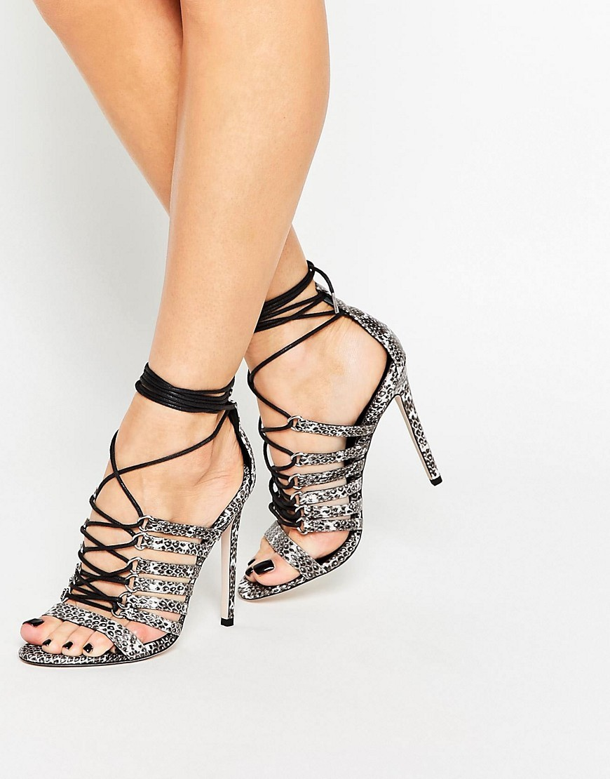 Hurricane Lace Up Heeled Sandals Snake - predominant colour: mid grey; secondary colour: black; occasions: evening, occasion; material: faux leather; ankle detail: ankle tie; heel: stiletto; toe: open toe/peeptoe; style: strappy; finish: plain; pattern: animal print; heel height: very high; season: s/s 2016; wardrobe: event