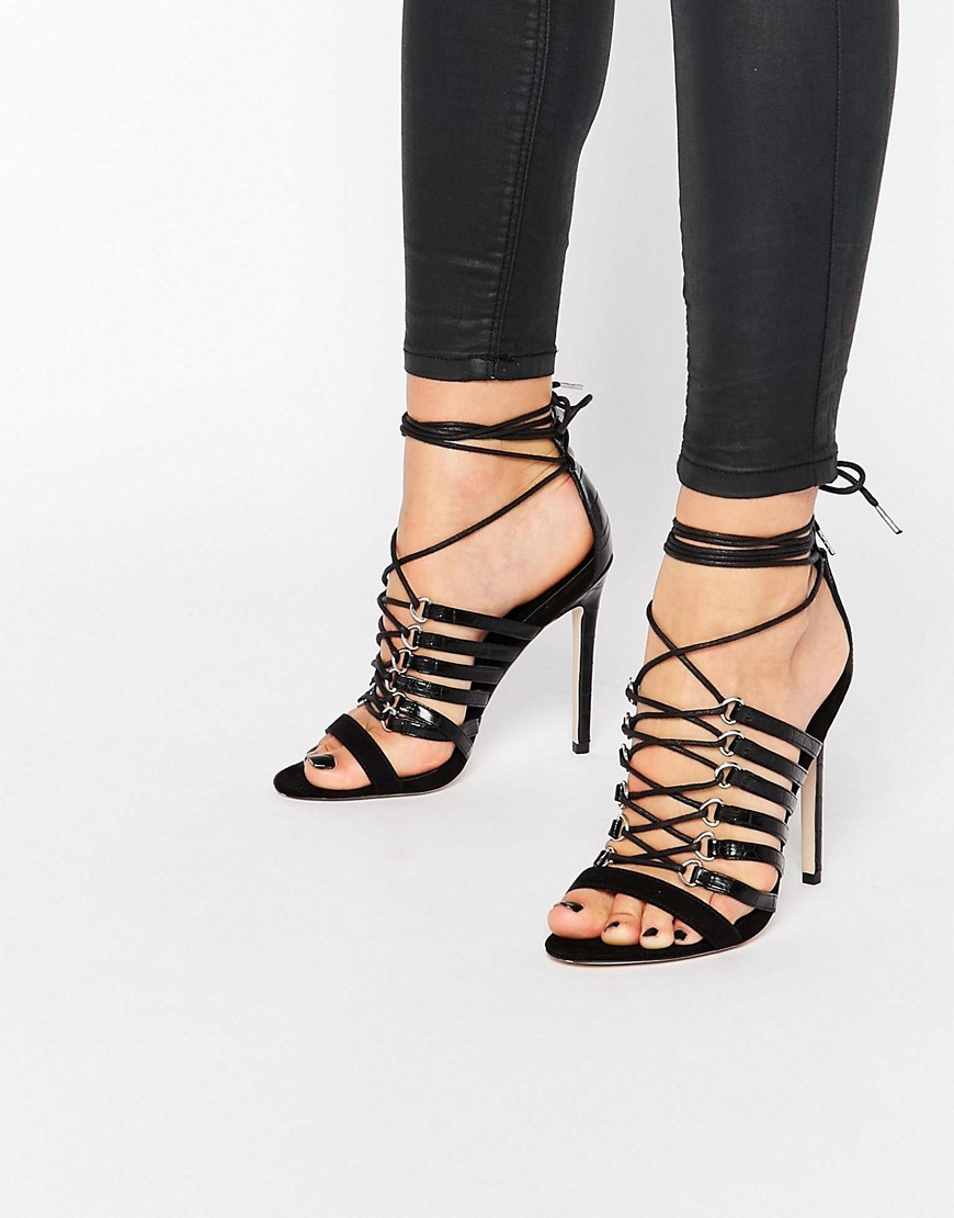 Hurricane Lace Up Heeled Sandals Black - predominant colour: black; occasions: evening, occasion; material: faux leather; ankle detail: ankle tie; heel: stiletto; toe: open toe/peeptoe; style: strappy; finish: plain; pattern: plain; heel height: very high; season: s/s 2016; wardrobe: event