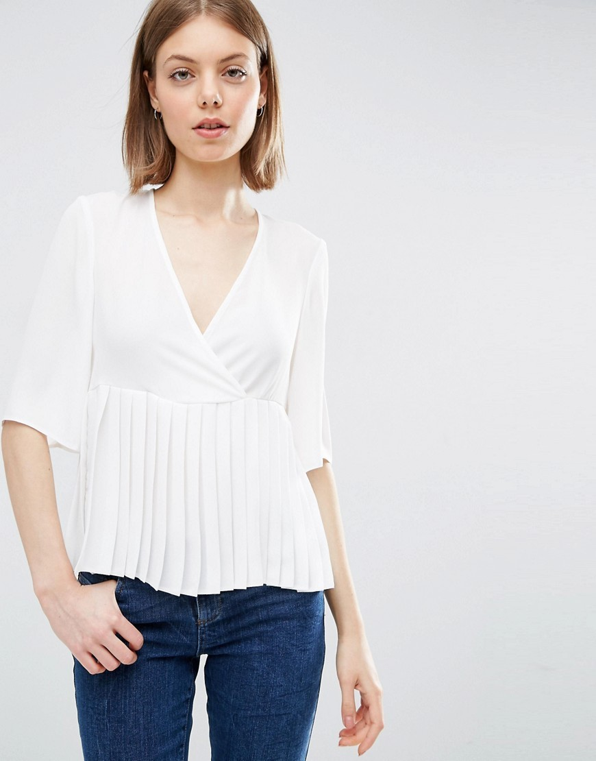 Wrap Front Pleat Peplum Top Ivory - neckline: v-neck; pattern: plain; waist detail: peplum waist detail; predominant colour: ivory/cream; occasions: work; length: standard; style: top; fibres: polyester/polyamide - 100%; fit: body skimming; sleeve length: half sleeve; sleeve style: standard; texture group: crepes; pattern type: fabric; season: s/s 2016; wardrobe: basic