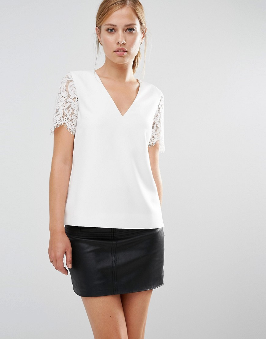Jessin Lace Sleeve Top Cream - neckline: low v-neck; pattern: plain; predominant colour: white; occasions: work; length: standard; style: top; fibres: polyester/polyamide - stretch; fit: body skimming; sleeve length: short sleeve; sleeve style: standard; pattern type: fabric; texture group: other - light to midweight; embellishment: lace; season: s/s 2016; wardrobe: highlight
