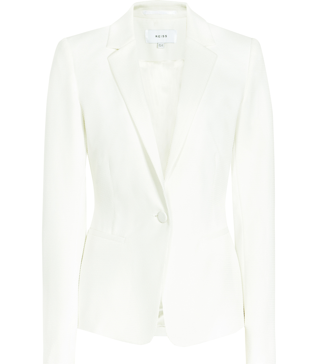 Hanneli Womens Ruffle Back Jacket In White - pattern: plain; style: single breasted blazer; collar: standard lapel/rever collar; predominant colour: white; occasions: work; length: standard; fit: tailored/fitted; fibres: polyester/polyamide - stretch; sleeve length: long sleeve; sleeve style: standard; collar break: medium; pattern type: fabric; texture group: woven light midweight; season: s/s 2016; wardrobe: investment