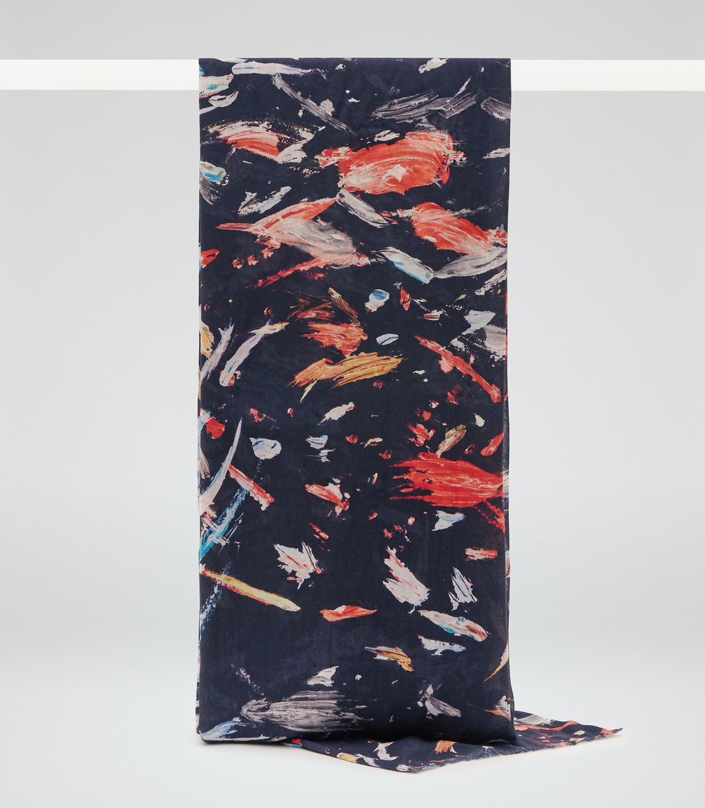 Lupo Womens Printed Scarf In Blue - predominant colour: navy; secondary colour: bright orange; occasions: casual; type of pattern: standard; style: regular; size: standard; material: fabric; pattern: patterned/print; multicoloured: multicoloured; season: s/s 2016; wardrobe: highlight