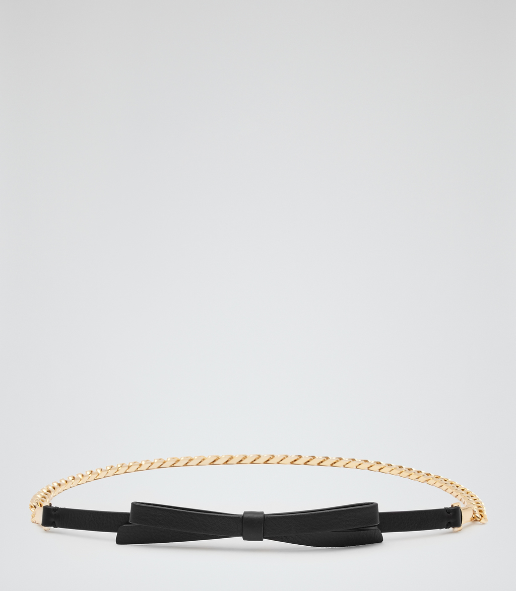 Marlie Womens Chain Detail Belt In Black - predominant colour: gold; secondary colour: black; occasions: casual; type of pattern: standard; style: chainlink; size: skinny; worn on: waist; material: chain/metal; pattern: plain; finish: plain; embellishment: bow; multicoloured: multicoloured; season: s/s 2016