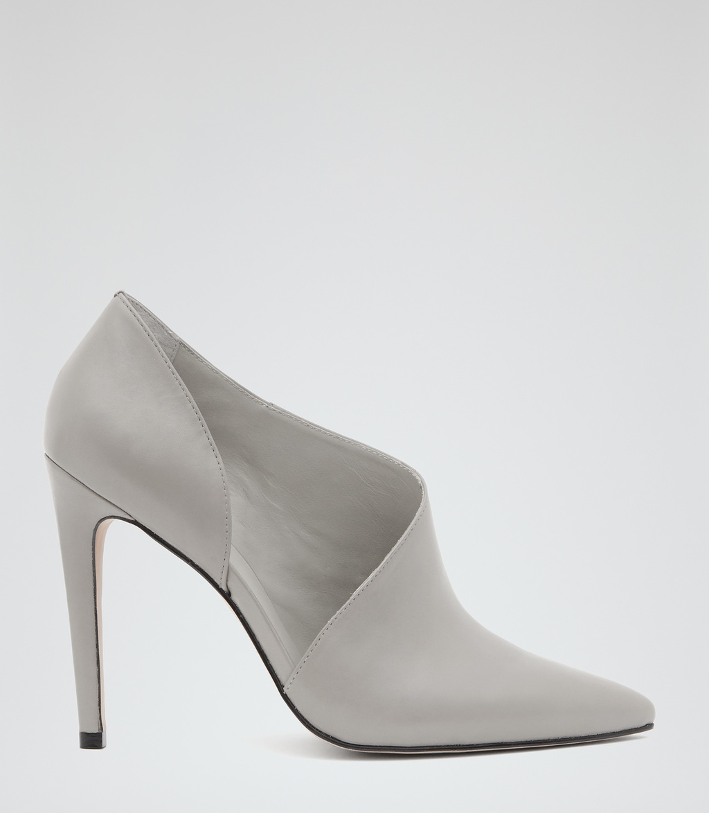 Connelly Womens Cut Out Ankle Boots In Grey - predominant colour: light grey; occasions: evening; material: leather; heel height: high; heel: stiletto; toe: pointed toe; boot length: shoe boot; style: standard; finish: plain; pattern: plain; season: s/s 2016; wardrobe: event