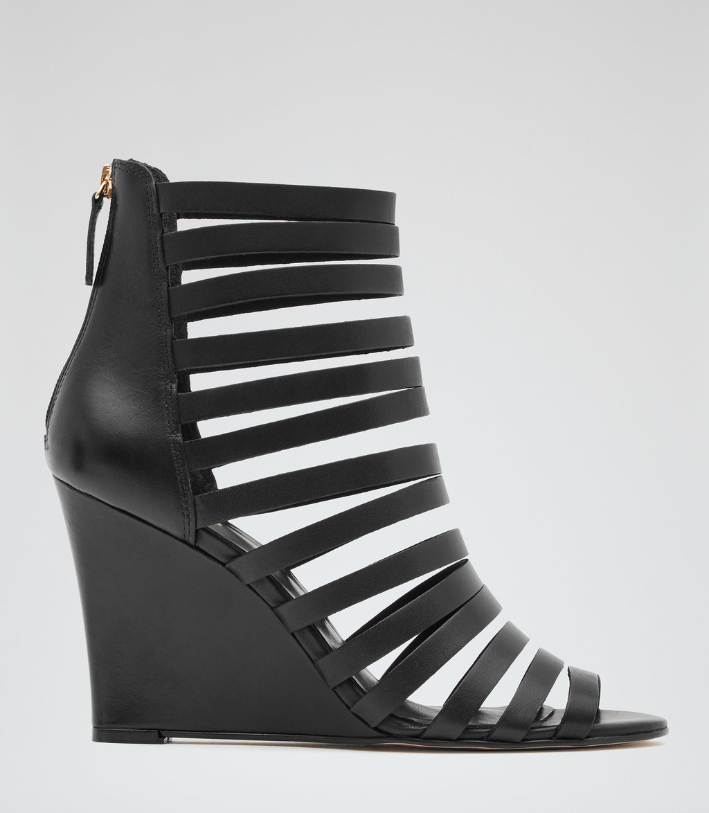 Amadeus Womens Multi Strap Wedges In Black - predominant colour: black; occasions: evening, holiday; material: leather; heel height: high; ankle detail: ankle strap; heel: wedge; toe: open toe/peeptoe; style: strappy; finish: plain; pattern: plain; season: s/s 2016; wardrobe: investment