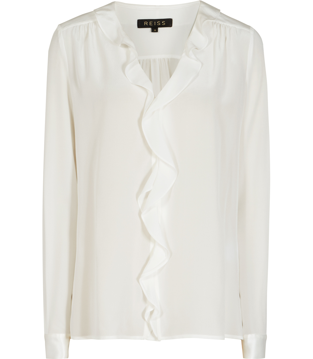 Kaye Womens Frill Detail Shirt In White - neckline: v-neck; pattern: plain; style: blouse; predominant colour: white; occasions: evening; length: standard; fibres: silk - 100%; fit: body skimming; sleeve length: long sleeve; sleeve style: standard; texture group: silky - light; bust detail: tiers/frills/bulky drapes/pleats; pattern type: fabric; season: s/s 2016
