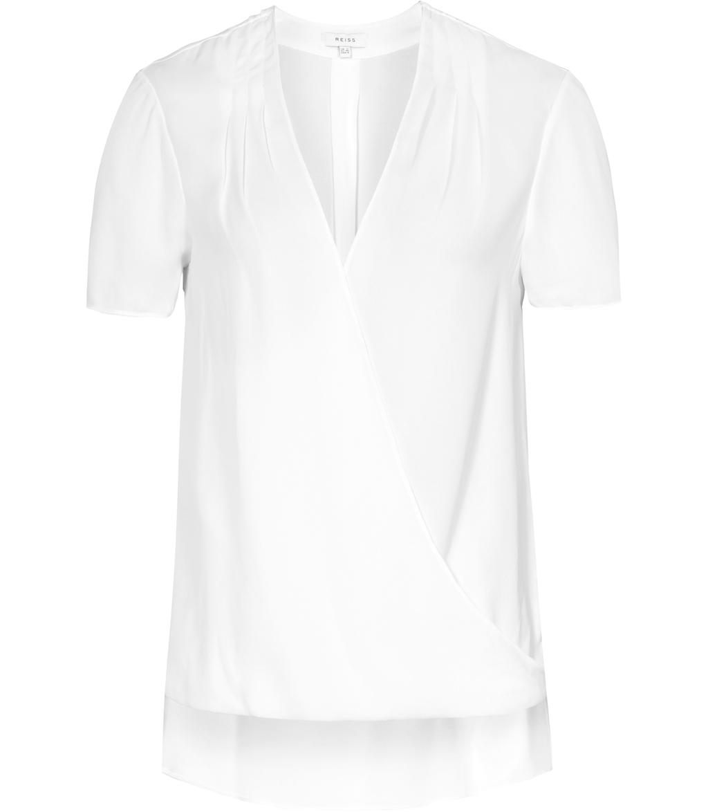 Bella Womens Wrap Top In White - neckline: v-neck; pattern: plain; style: wrap/faux wrap; predominant colour: white; occasions: evening, work; length: standard; fibres: viscose/rayon - 100%; fit: body skimming; sleeve length: short sleeve; sleeve style: standard; texture group: sheer fabrics/chiffon/organza etc.; pattern type: fabric; season: s/s 2016; wardrobe: basic