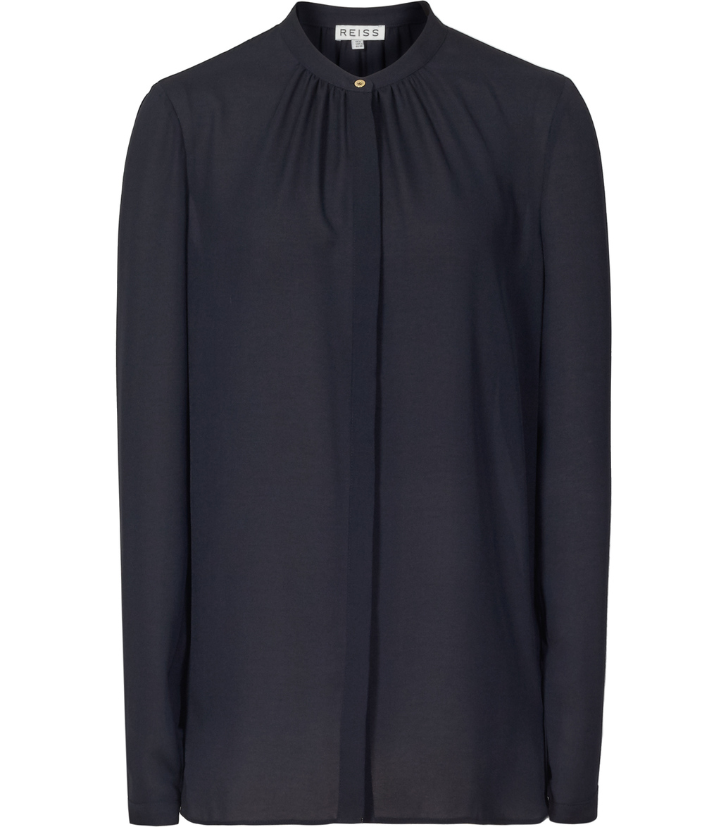 Holloway Womens Pintuck Neckline Blouse In Blue - pattern: plain; length: below the bottom; style: blouse; predominant colour: navy; occasions: evening, work, creative work; neckline: collarstand; fibres: polyester/polyamide - 100%; fit: straight cut; sleeve length: long sleeve; sleeve style: standard; pattern type: fabric; texture group: other - light to midweight; season: s/s 2016; wardrobe: basic