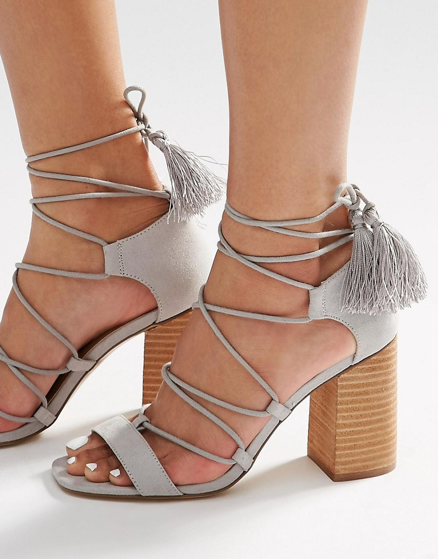 Tact Lace Up Tassel Heeled Sandals Grey - secondary colour: camel; predominant colour: light grey; occasions: casual, creative work; material: faux leather; heel height: mid; embellishment: tassels; ankle detail: ankle tie; heel: block; toe: open toe/peeptoe; style: strappy; finish: plain; pattern: colourblock; season: s/s 2016