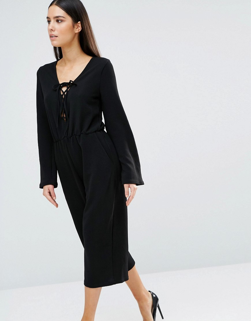 Lace Up Culotte Jumpsuit Black - neckline: low v-neck; sleeve style: bell sleeve; fit: fitted at waist; pattern: plain; length: below the knee; predominant colour: black; occasions: evening; fibres: polyester/polyamide - stretch; sleeve length: long sleeve; style: jumpsuit; pattern type: fabric; texture group: jersey - stretchy/drapey; season: s/s 2016