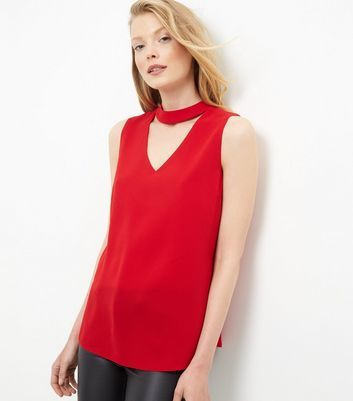 Red Cut Out Shell Top - pattern: plain; sleeve style: sleeveless; predominant colour: true red; occasions: evening; length: standard; style: top; neckline: peep hole neckline; fibres: polyester/polyamide - stretch; fit: body skimming; sleeve length: sleeveless; texture group: sheer fabrics/chiffon/organza etc.; pattern type: fabric; season: s/s 2016; wardrobe: event