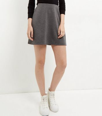 Grey Mini Skirt - length: mini; pattern: plain; fit: loose/voluminous; waist: high rise; predominant colour: charcoal; occasions: casual, creative work; style: a-line; fibres: polyester/polyamide - stretch; texture group: jersey - clingy; pattern type: fabric; season: s/s 2016