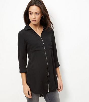 Black Zip Front Shirt - neckline: low v-neck; pattern: plain; length: below the bottom; style: shirt; predominant colour: black; occasions: casual, creative work; fibres: viscose/rayon - 100%; fit: body skimming; back detail: longer hem at back than at front; sleeve length: long sleeve; sleeve style: standard; pattern type: fabric; texture group: jersey - stretchy/drapey; embellishment: zips; season: s/s 2016; wardrobe: highlight; embellishment location: bust