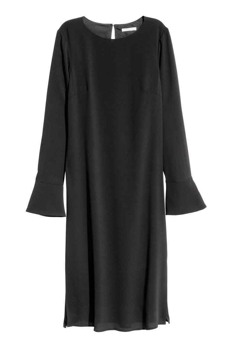 Crêpe Dress - style: shift; neckline: round neck; pattern: plain; sleeve style: volant; predominant colour: black; occasions: evening, creative work; length: on the knee; fit: straight cut; fibres: polyester/polyamide - 100%; sleeve length: long sleeve; texture group: crepes; pattern type: fabric; season: s/s 2016; wardrobe: investment