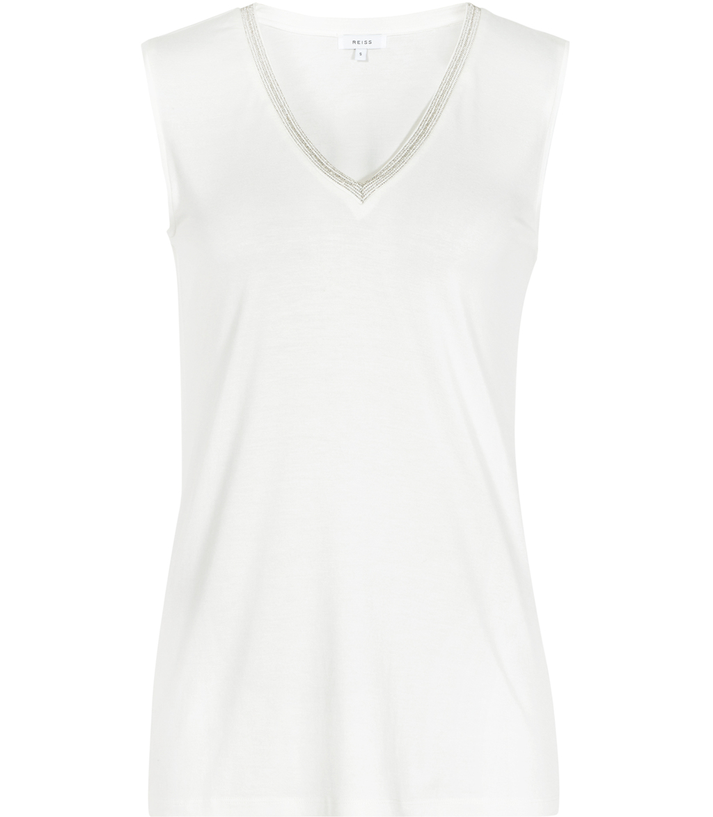 Faye Womens Embellished Tank Top In White - neckline: v-neck; pattern: plain; sleeve style: sleeveless; style: vest top; predominant colour: white; occasions: casual, creative work; length: standard; fibres: polyester/polyamide - 100%; fit: body skimming; sleeve length: sleeveless; pattern type: fabric; texture group: jersey - stretchy/drapey; embellishment: crystals/glass; season: s/s 2016; wardrobe: highlight