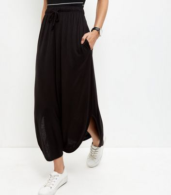 Jdy Black Split Side Maxi Skirt - pattern: plain; length: ankle length; fit: loose/voluminous; waist: mid/regular rise; predominant colour: black; occasions: casual; style: maxi skirt; fibres: viscose/rayon - 100%; pattern type: fabric; texture group: jersey - stretchy/drapey; season: s/s 2016; wardrobe: basic