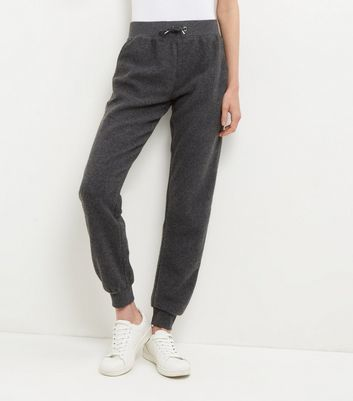Dark Grey Brushed Joggers - length: standard; pattern: plain; style: tracksuit pants; waist detail: belted waist/tie at waist/drawstring; waist: mid/regular rise; predominant colour: charcoal; occasions: casual; fibres: cotton - stretch; fit: baggy; pattern type: fabric; texture group: jersey - stretchy/drapey; pattern size: standard (bottom); season: s/s 2016; wardrobe: basic