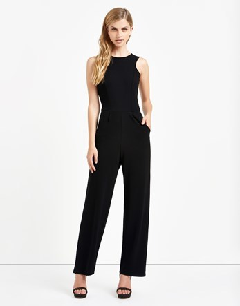 Round Neck Textured Jumpsuit - length: standard; neckline: round neck; fit: tailored/fitted; pattern: plain; sleeve style: sleeveless; predominant colour: black; occasions: evening, occasion; fibres: polyester/polyamide - stretch; sleeve length: sleeveless; style: jumpsuit; pattern type: fabric; texture group: other - light to midweight; season: a/w 2016; wardrobe: event