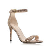 Mana - predominant colour: champagne; occasions: evening, holiday; material: faux leather; heel height: high; ankle detail: ankle strap; heel: stiletto; toe: open toe/peeptoe; style: standard; finish: metallic; pattern: animal print; season: a/w 2016; wardrobe: highlight