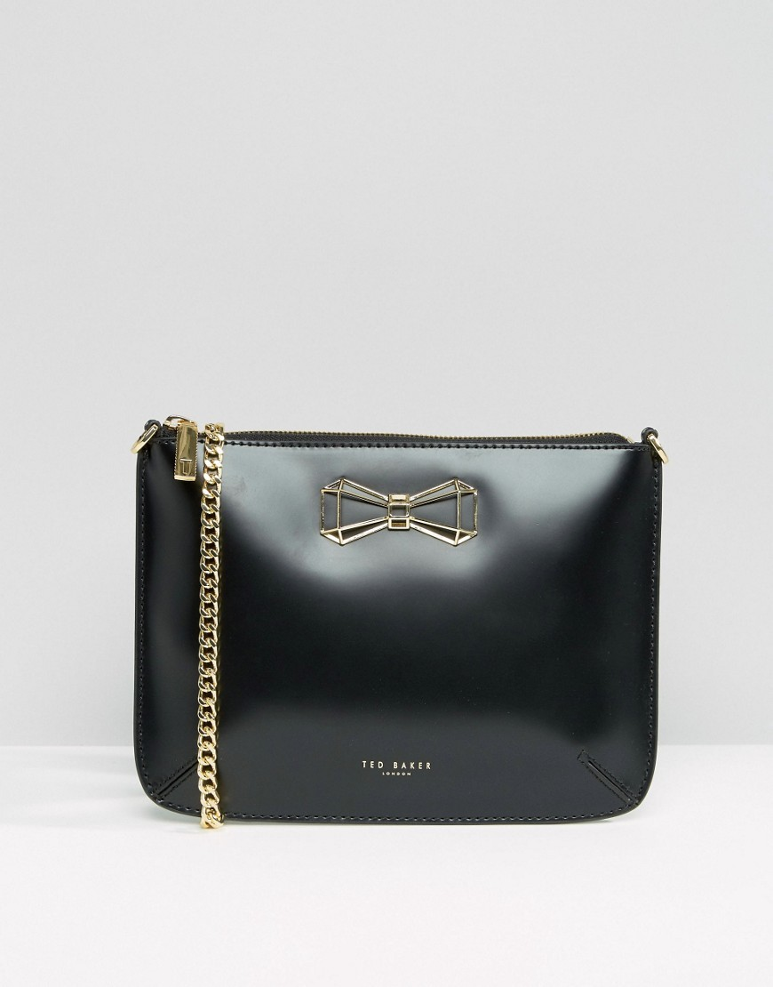 Leather Cross Body Bag With Bow Black - secondary colour: gold; predominant colour: black; occasions: casual; type of pattern: standard; style: messenger; length: across body/long; size: small; material: leather; pattern: plain; finish: plain; embellishment: chain/metal; season: a/w 2016; wardrobe: highlight