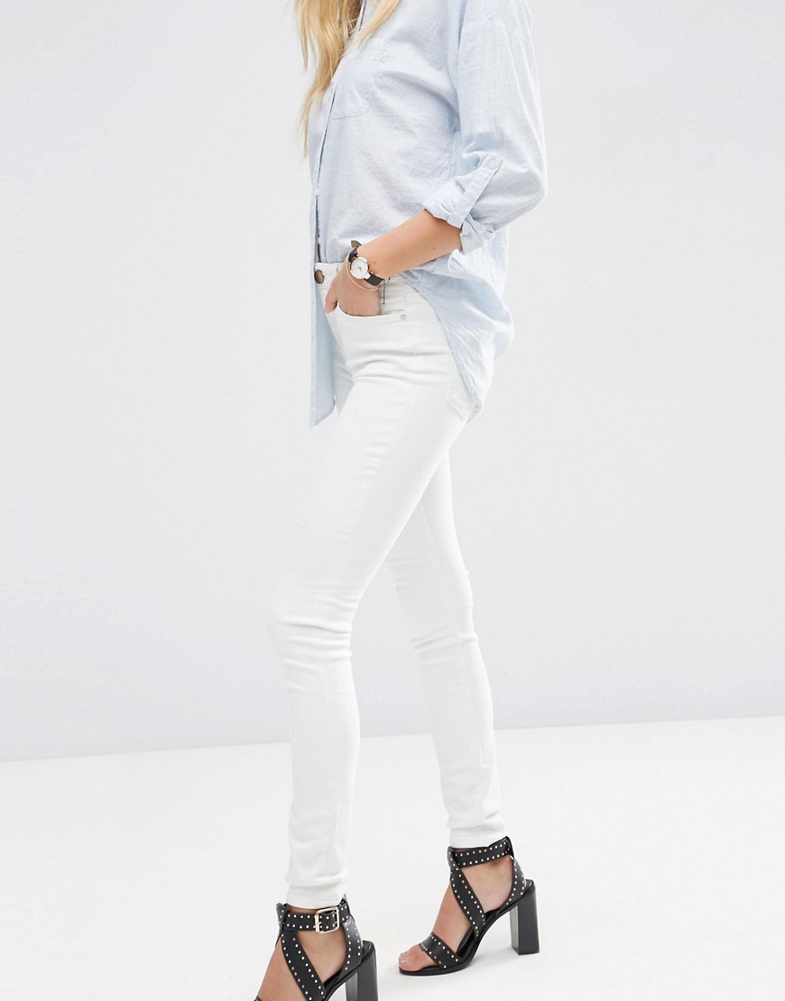 Lisbon Skinny Mid Rise Jeans In Off White Off White - style: skinny leg; length: standard; pattern: plain; waist: high rise; pocket detail: traditional 5 pocket; predominant colour: white; occasions: casual; fibres: cotton - stretch; texture group: denim; pattern type: fabric; season: a/w 2016