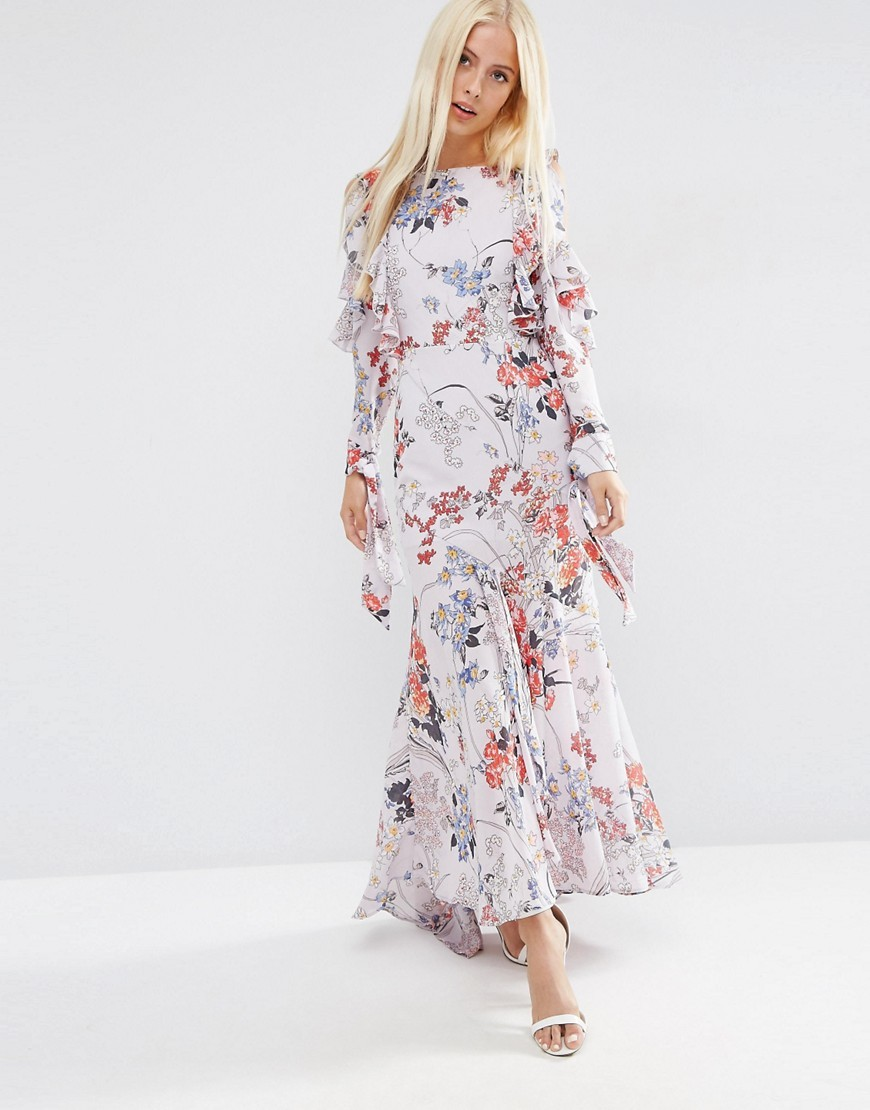 Cold Shoulder Long Sleeve Ruffle Maxi Dress In Grey Floral Multi - neckline: slash/boat neckline; style: maxi dress; length: ankle length; predominant colour: white; secondary colour: pink; occasions: evening; fit: body skimming; fibres: polyester/polyamide - 100%; sleeve length: long sleeve; sleeve style: standard; texture group: sheer fabrics/chiffon/organza etc.; pattern type: fabric; pattern: florals; multicoloured: multicoloured; season: a/w 2016; wardrobe: event