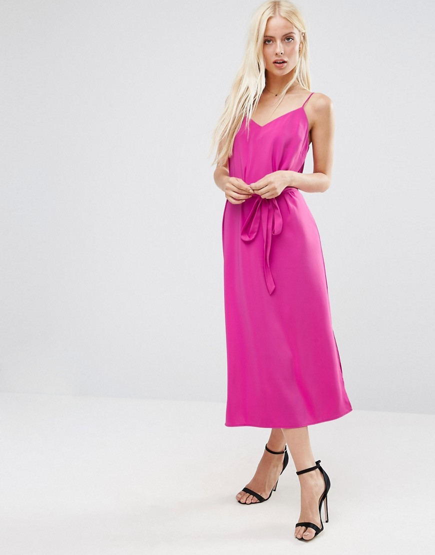 Midi Slip Dress In With Tie Waist Bright Pink - length: calf length; neckline: low v-neck; sleeve style: spaghetti straps; pattern: plain; style: vest; waist detail: belted waist/tie at waist/drawstring; predominant colour: hot pink; occasions: casual; fit: body skimming; fibres: polyester/polyamide - stretch; sleeve length: sleeveless; texture group: crepes; pattern type: fabric; season: a/w 2016; wardrobe: highlight