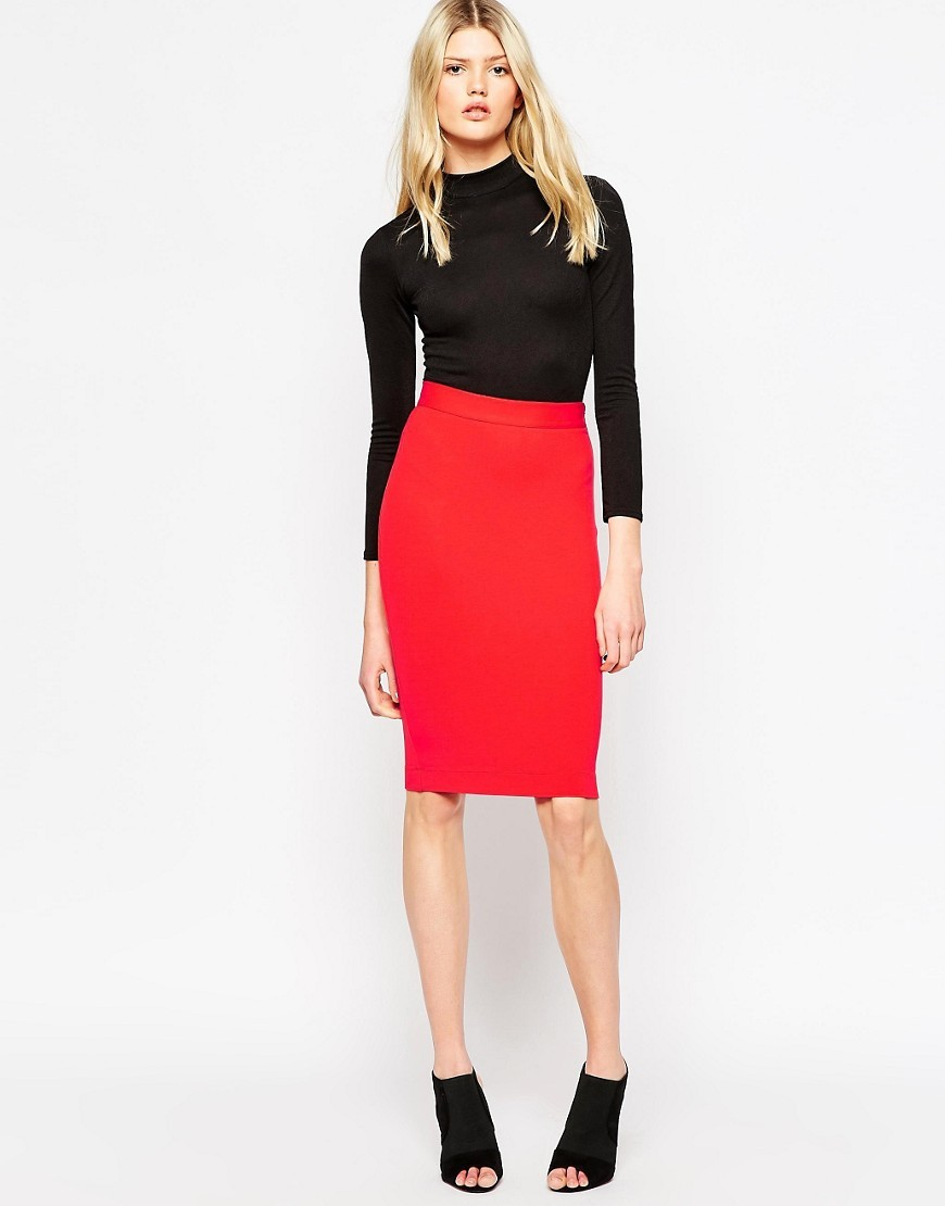 Lula Stretch Pencil Skirt In Red Riot Red - pattern: plain; style: pencil; fit: tight; waist: mid/regular rise; predominant colour: true red; occasions: evening; length: on the knee; fibres: viscose/rayon - stretch; texture group: jersey - clingy; pattern type: fabric; season: a/w 2016; wardrobe: event