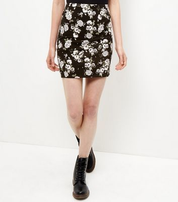 Black Floral Print Tube Skirt - length: mini; fit: tight; waist: mid/regular rise; secondary colour: white; predominant colour: black; occasions: casual; fibres: polyester/polyamide - stretch; style: tube; texture group: jersey - clingy; pattern type: fabric; pattern: florals; pattern size: big & busy (bottom); multicoloured: multicoloured; season: a/w 2016; wardrobe: highlight
