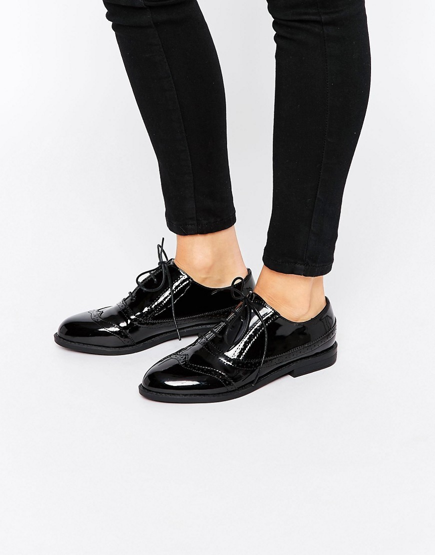 Mayhem Brogues Black - predominant colour: black; occasions: casual, work, creative work; material: faux leather; heel height: flat; toe: round toe; style: brogues; finish: patent; pattern: plain; wardrobe: basic; season: a/w 2016